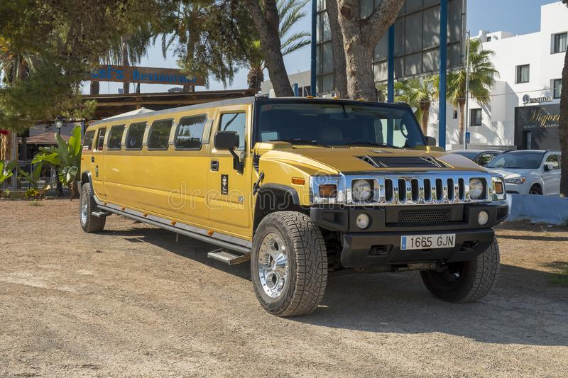 Hummer Limousine. Big dark yellow Hummer Limousine used for transporting people to parties and weddings royalty free stock photography