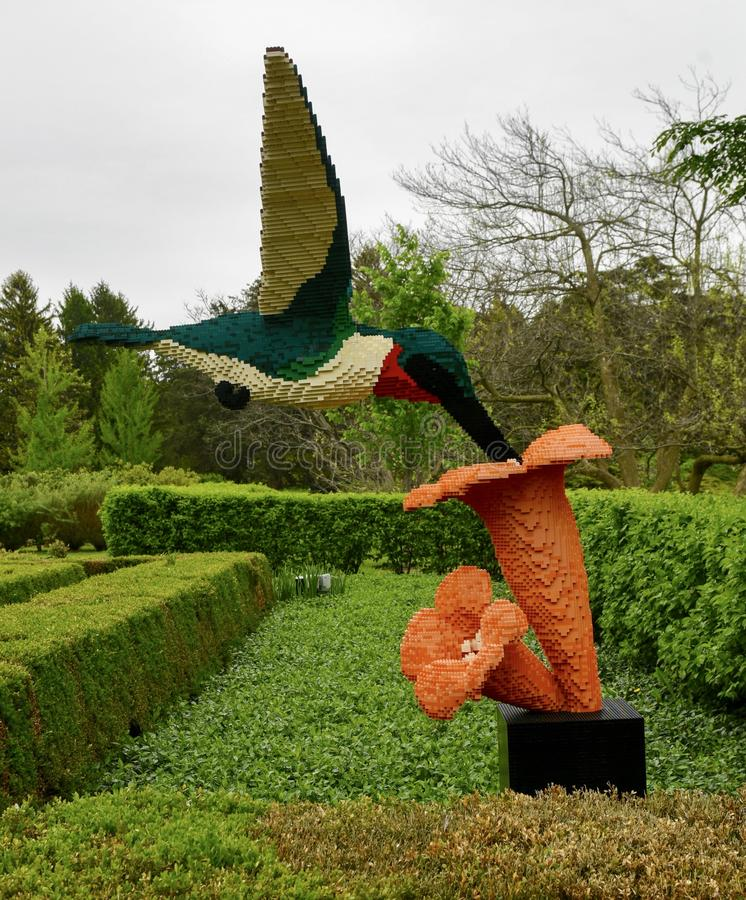 Hummingbird on TrumpetFlower. This is a Spring picture of a piece of public art titled: Hummingbird on Trumpet Flower, on exhibit at the Morton Arboretum in stock photos