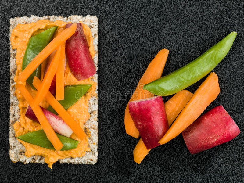 Hummous on Crispbread With Vegetables stock image