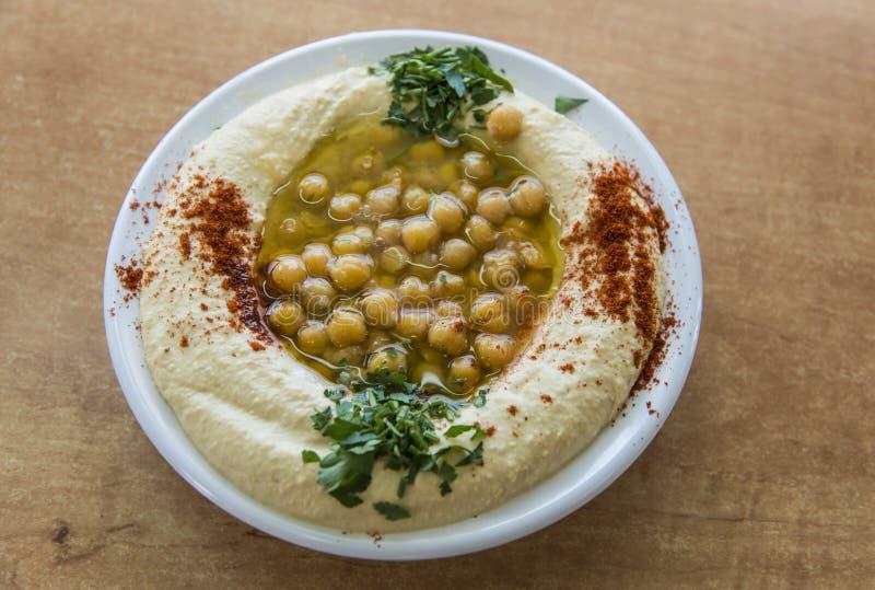 Hummus с оливковым маслом стоковые изображения