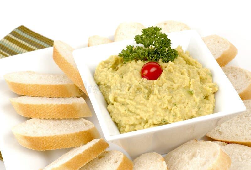Hummus asado del ajo. imagen de archivo