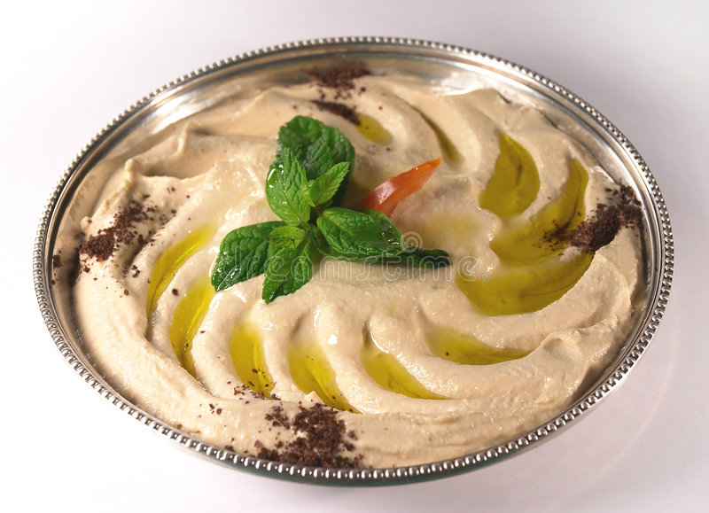 Hummus auf einem Tellersegment stockbild