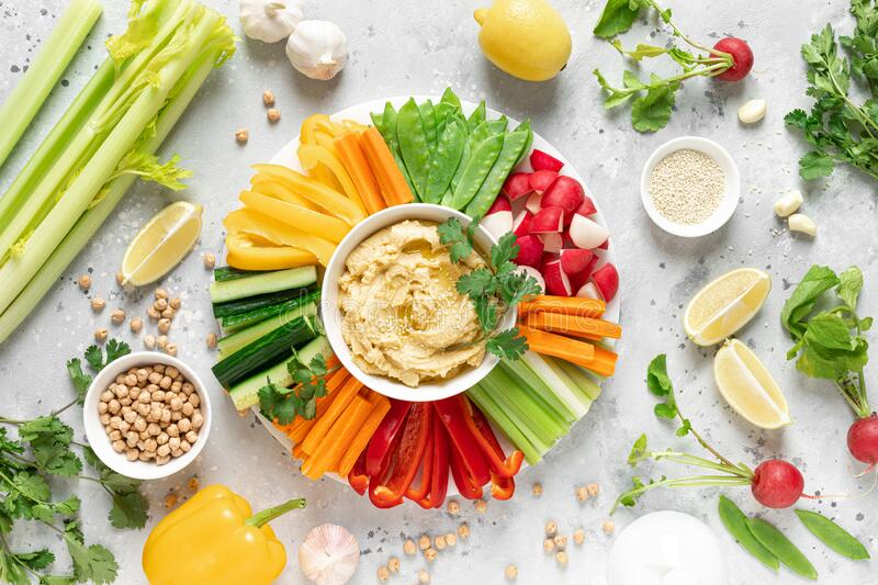 Chickpea hummus with fresh vegetables, healthy vegetarian food concept stock image