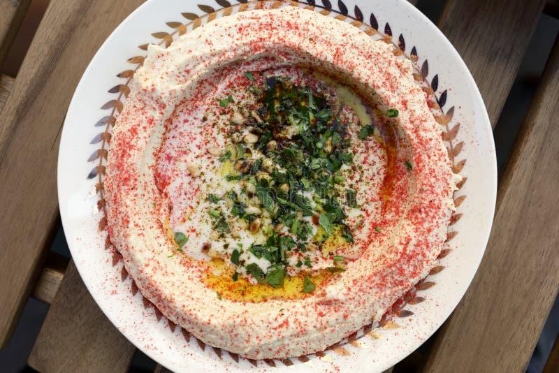 Hummus med tahini och kryddan arkivfoto