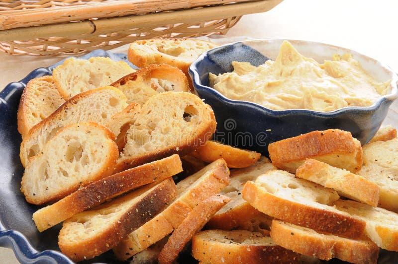 Hummus and mini toasts royalty free stock photography