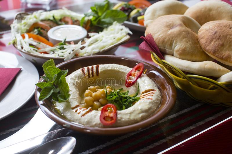 Hummus served with pita bread stock photography