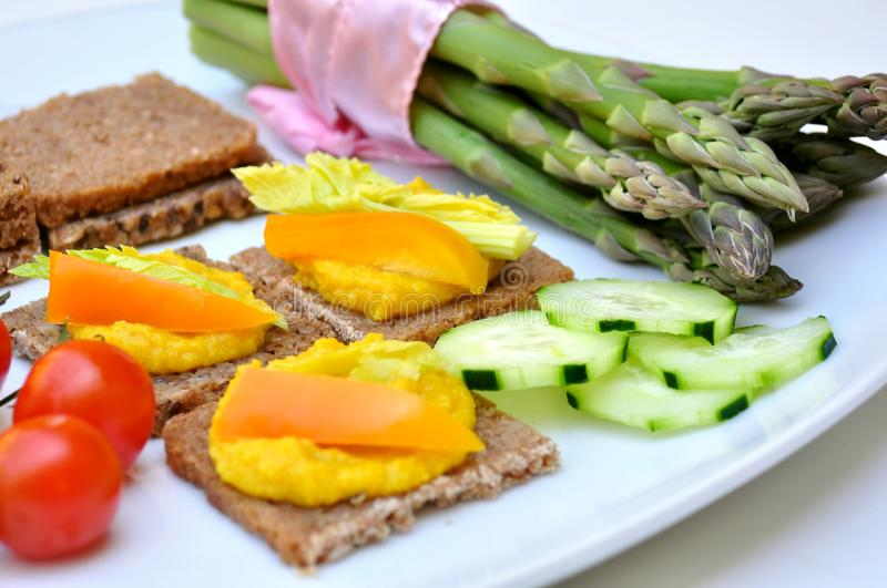 Hummus and vegetables lunch , vegan meal stock images