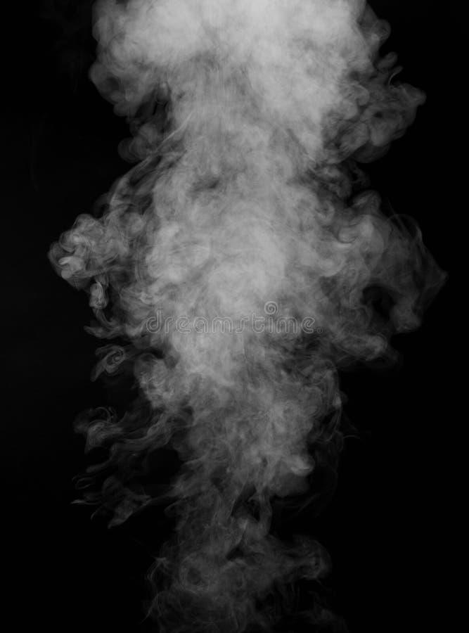 Humo aislado en fondo negro imagen de archivo