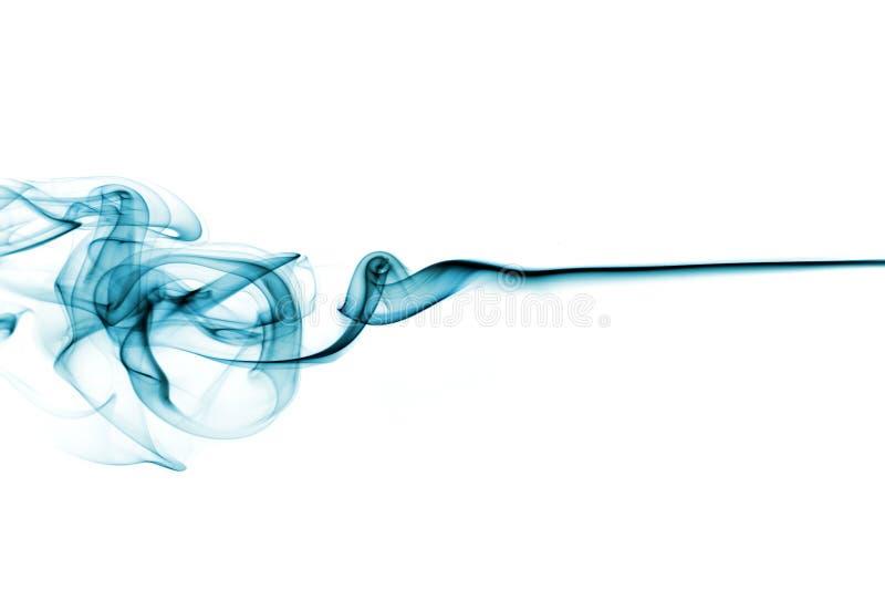 Humo azul en blanco foto de archivo libre de regalías