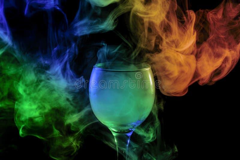 humo Azul-verde-anaranjado en el vidrio Víspera de Todos los Santos fotos de archivo