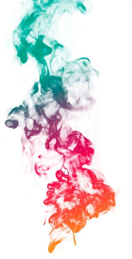 Humo colorido de la fantasía en el fondo blanco fotos de archivo