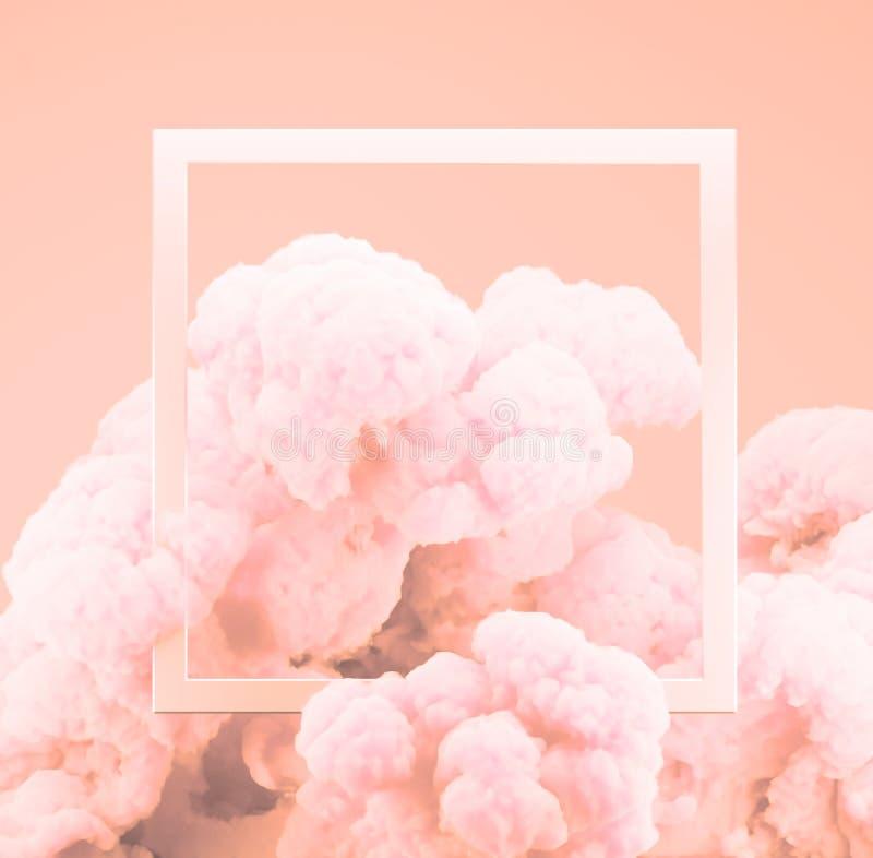 Humo coralino vivo en colores pastel o explosión de la pintura del color del extracto con el fondo rosado en colores pastel imágenes de archivo libres de regalías