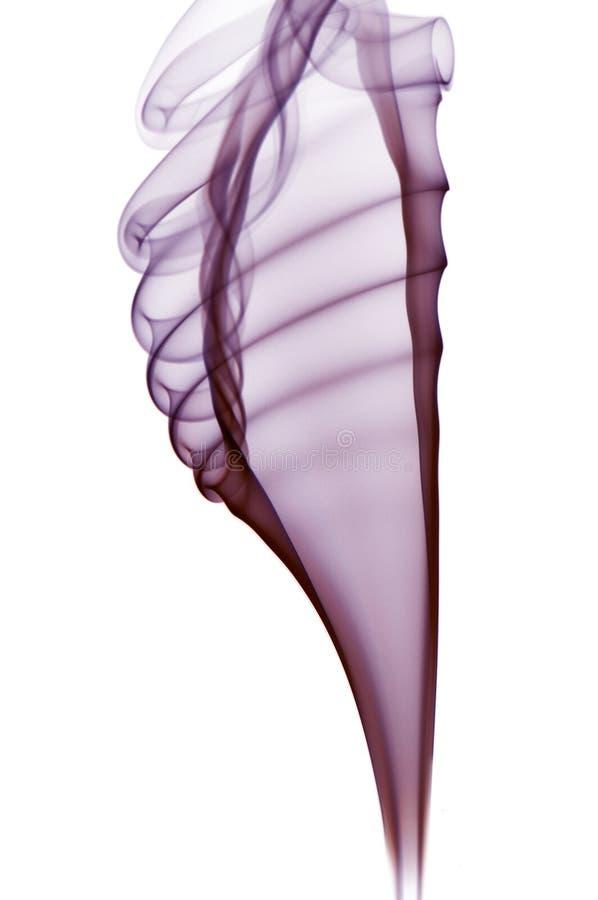 Humo púrpura en el fondo blanco fotografía de archivo libre de regalías