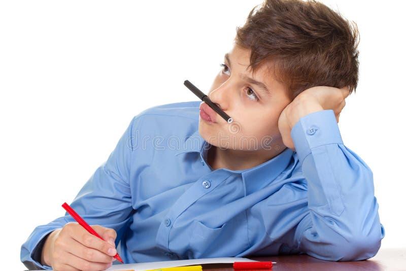 Humor da escola da educação do caderno do menino, aprendizagem da estudante foto de stock