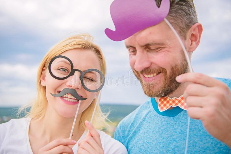 Humor and laugh concept. Couple posing with party props sky background. Photo booth props. Man with beard and woman. Humor and laugh concept. Couple posing with royalty free stock photos