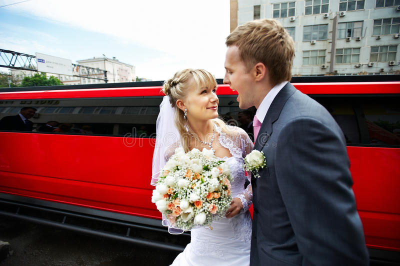 Download Humorous Picture Bride And Groom On Red Limo Stock Photo - Image: 13042278