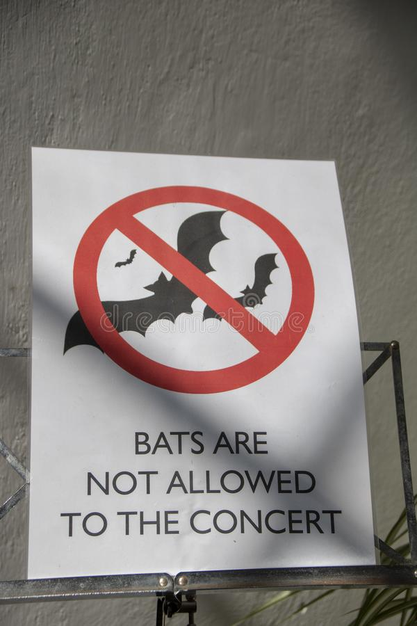 Bats not allowed. Humorous prohibition sign: bats not allowed to the concert royalty free stock photos