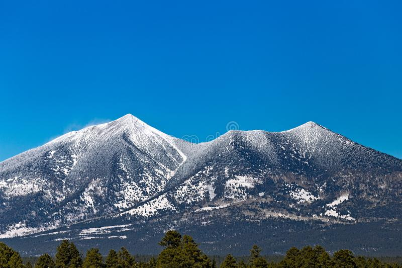 Humphreys Peak near Flagstaff, Arizona. Covered in fresh snow. Humphreys is the tallest mountain in Arizona and the highest summit in the San Francisco Peaks stock image