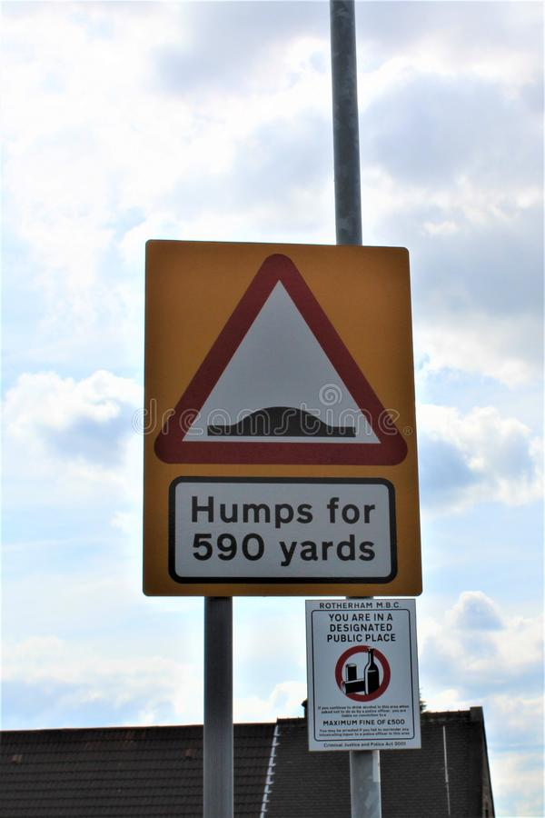 Humps in road sign stock photo
