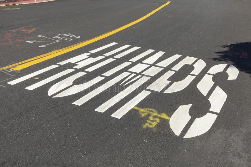 Humps sign painted at street to warn cars and force them to reduce speed royalty free stock photos
