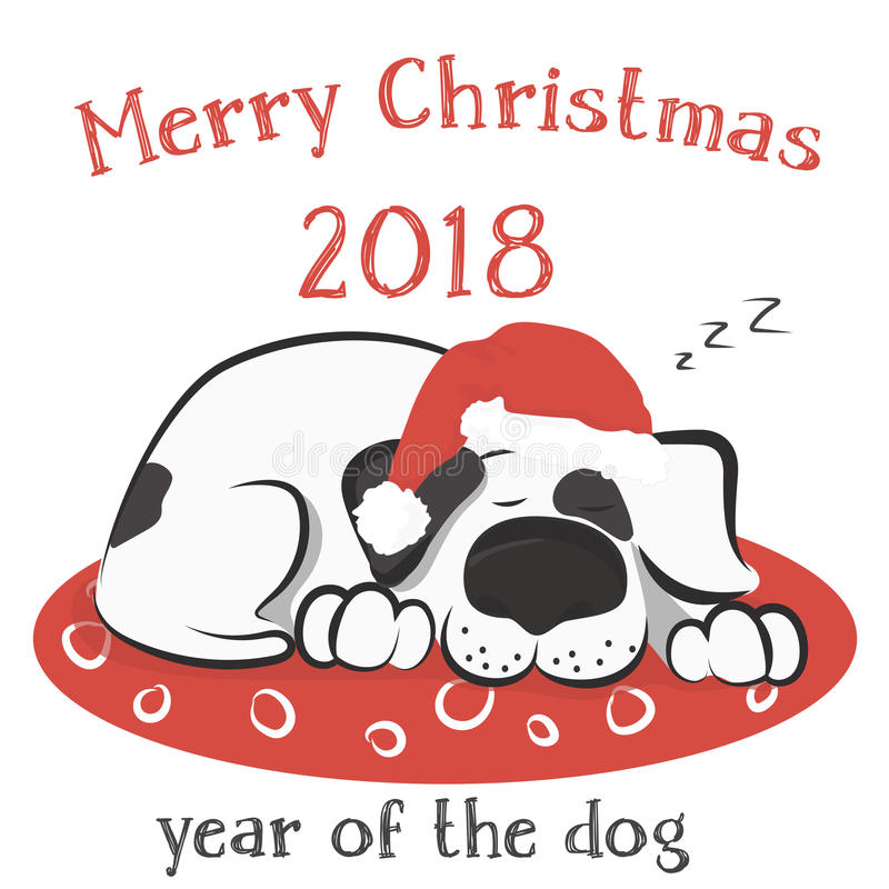 Hunden sover på kudden i jultomtenhatten arkivfoton