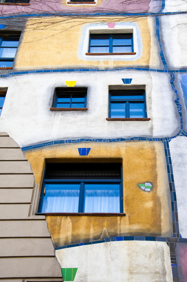 Hundertwasser House in Vienna, Austria. Hundertwasser claimed that architecture should not conformed to straight lines and flat floors as it is going against stock photos