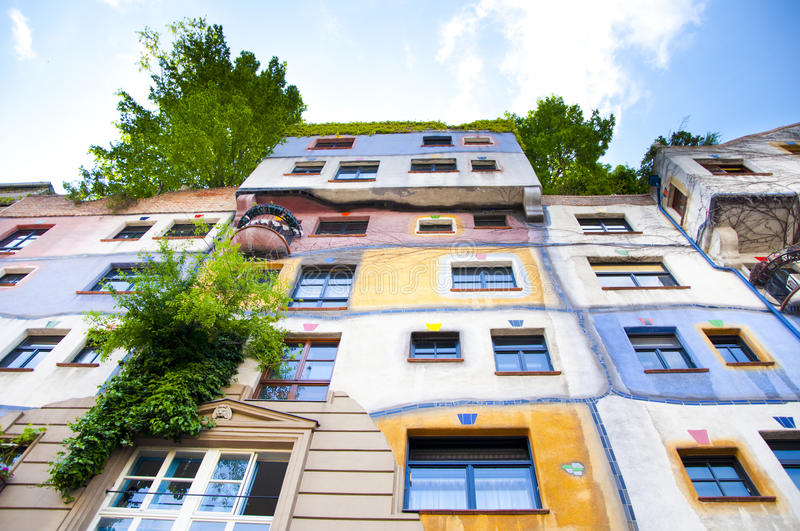 Hundertwasser House in Vienna, Austria. Hundertwasser claimed that architecture should not conformed to straight lines and flat floors as it is going against stock image