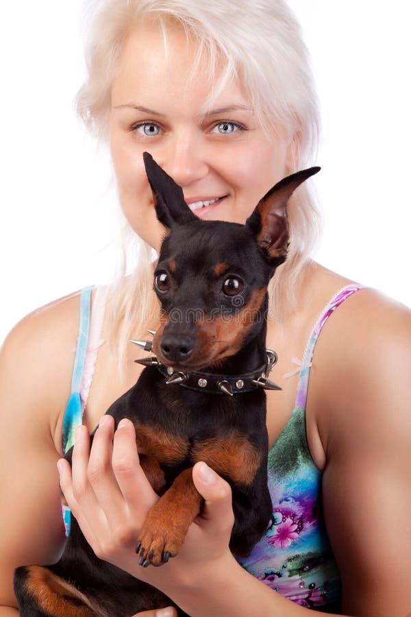 hundflicka henne holding royaltyfri foto