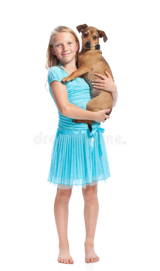 hundflicka henne holdingbarn arkivfoto