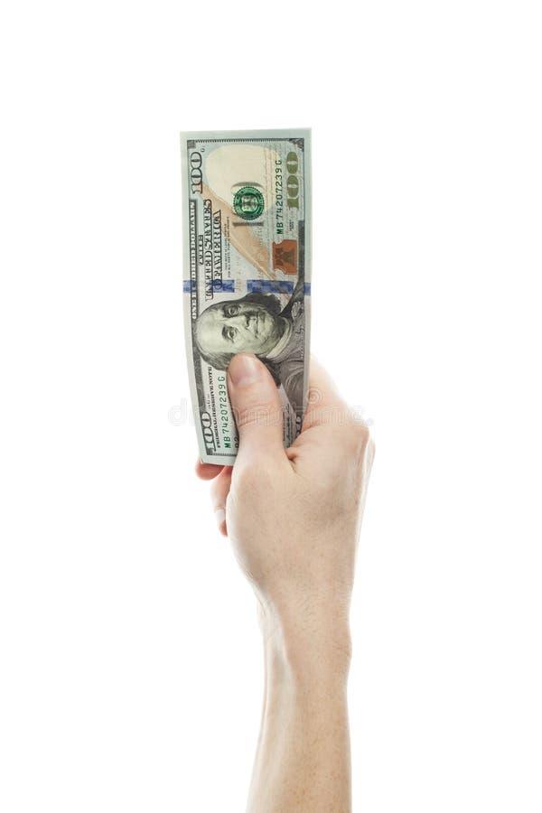 Hundra dollar i den manliga handen som isoleras på vit bakgrund royaltyfri bild