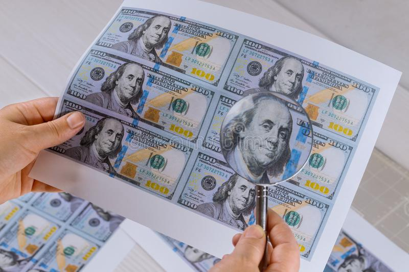 Hundred dollar bill for magnifying glass high security print. Counterfeiting dollar bills, crime, banknote, illegal, punishment, forgery, money, currency, cash stock images