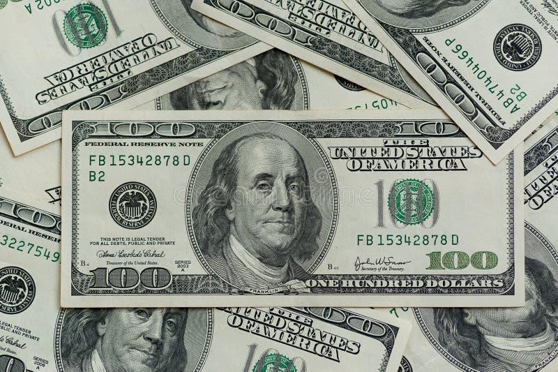 Hundred dollar bills. Macro photography of banknotes. The motion camera slider royalty free stock image