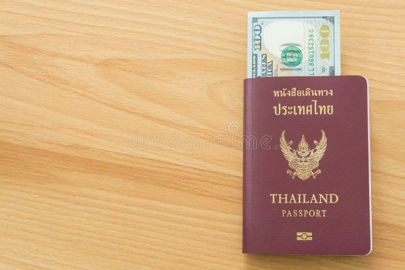 Hundred dollar bills passport. Hundred dollar bills thai passport stock photo