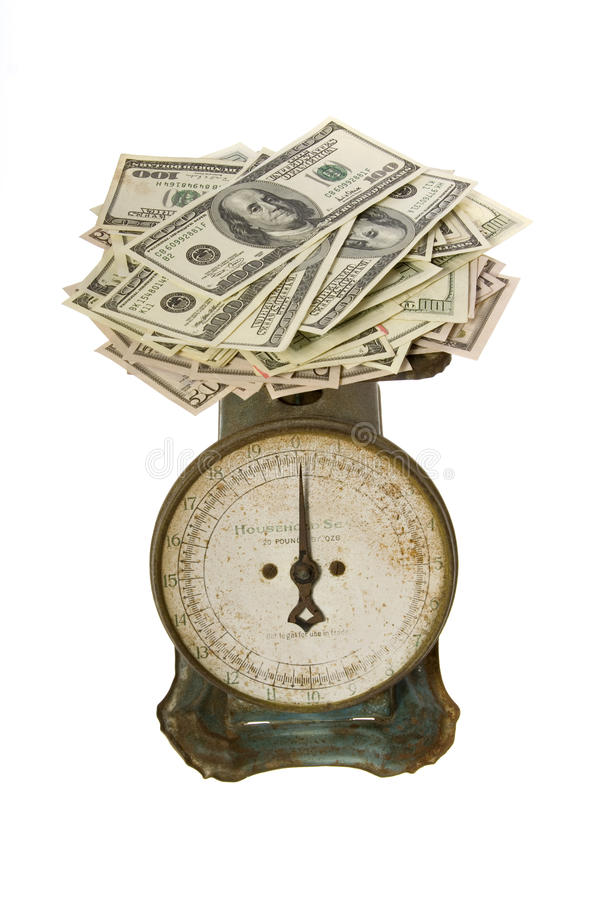Hundred Dollar Bills Weigh on Scale stock image