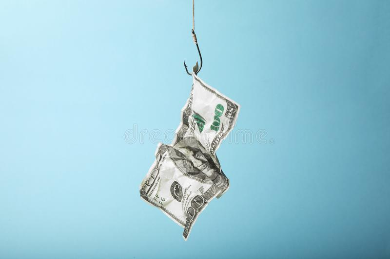 Hundred dollars on hook is trap. Dependence on loans and credits.  stock images
