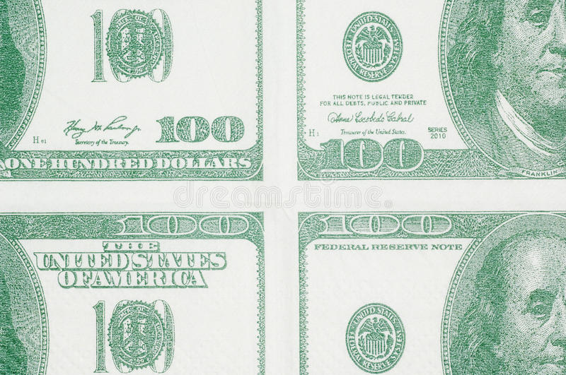 Hundred dollars in quarters. Quarter sections head on of hundred dollar bills royalty free stock photography