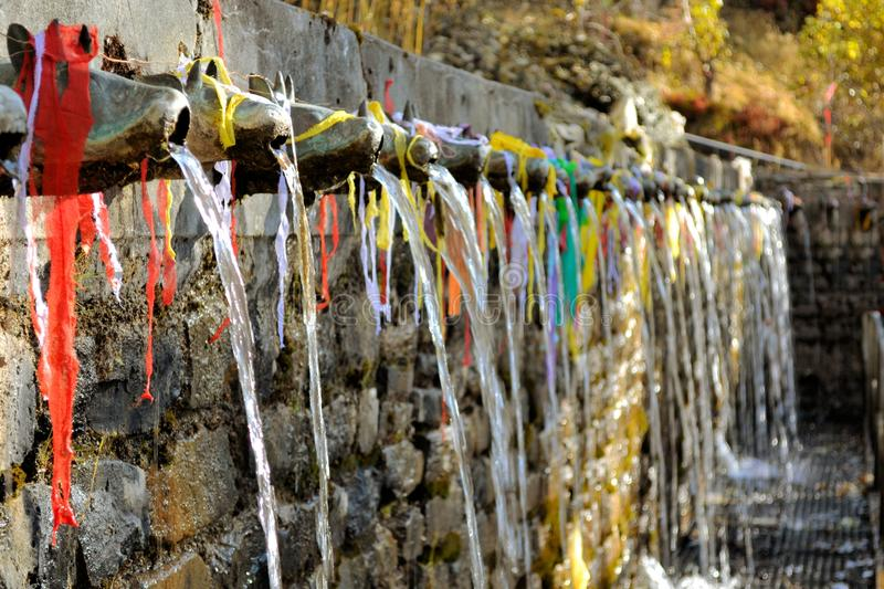 Hundred and eight holy fountains of Muktinath. 108 fountains and pool with holy spring water in Muktinath Hindu tempe, Annapurna Mountain range, Nepal royalty free stock photography