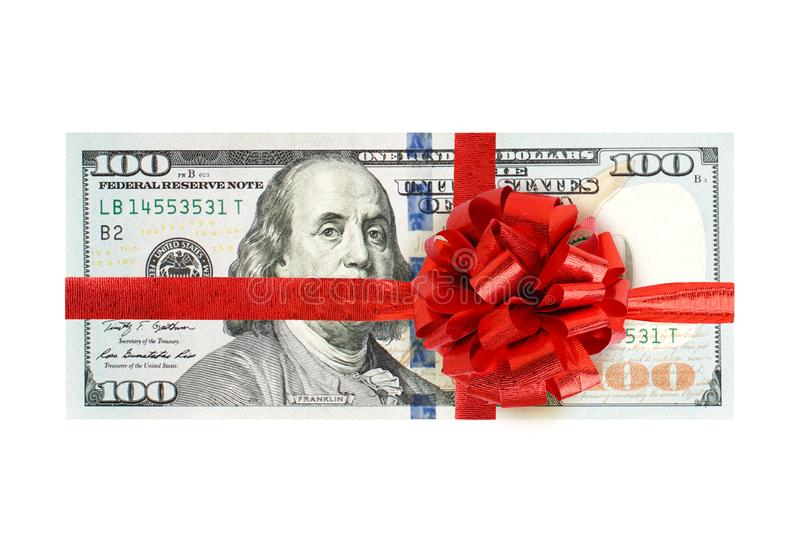 Hundred us dollar with red ribbon isolated on white background. Gift 100 US Dollar bank note cash money.  royalty free stock images