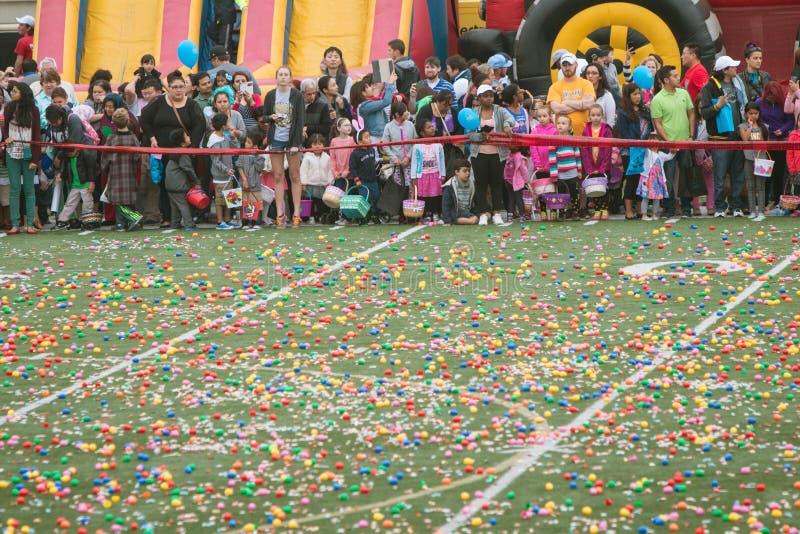 Hundreds Eagerly Await Start Of Massive Community Easter Egg Hunt. Marietta, GA, USA - March 26, 2016: Children and families eagerly await the start of a massive stock photos