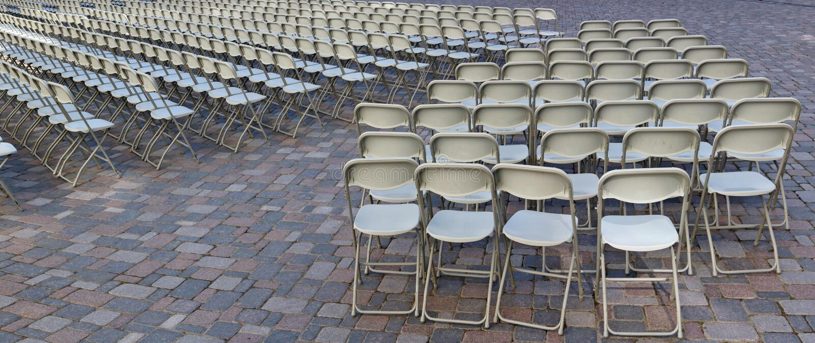 Hundreds of folding chairs are installed on the granite square. Of the old European city. Soon there will begin a concert of classical music stock photo