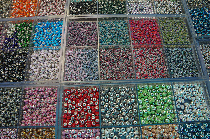 Hundreds of multi color beads above view stock image