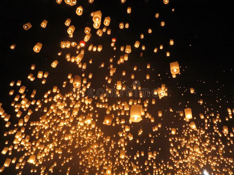 Hundreds of paper lanterns let off into the night skies. A photo taken on hundreds of paper lanterns let off into the night skies royalty free stock images