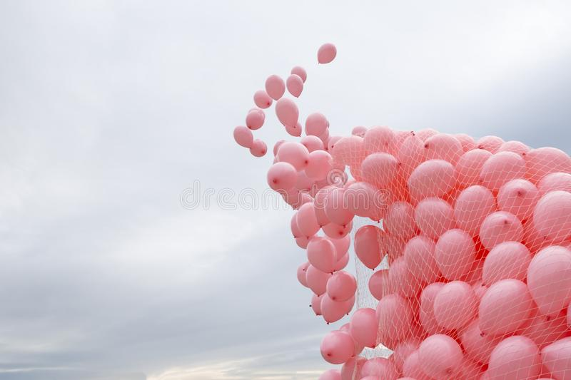 Pink balloons breast cancer. Hundreds of pink balloons are released in memory of women passed away because of breast cancer last year stock photography