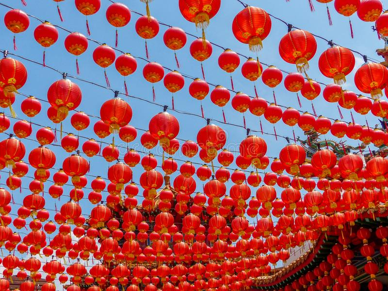 Hundreds of Red Chinese lanterns at a Chinese Temple. A colourful and dramatic red canopy of hanging chinese lanterns at a chinese temple in Kuala Lumpur royalty free stock photography