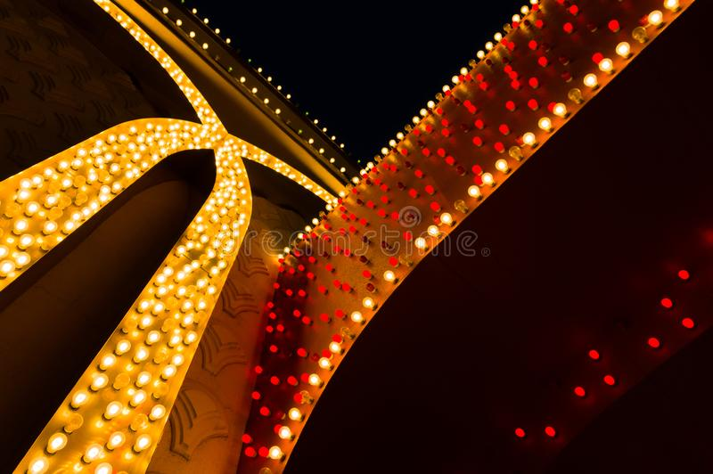 Hundreds of small lightbulbs forming spripes on building wall stock images