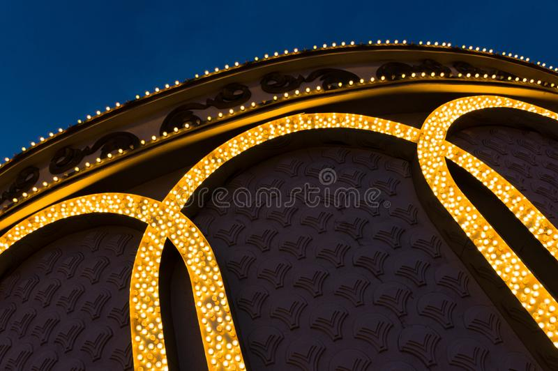 Hundreds of small lightbulbs forming spripes on building wall stock photo