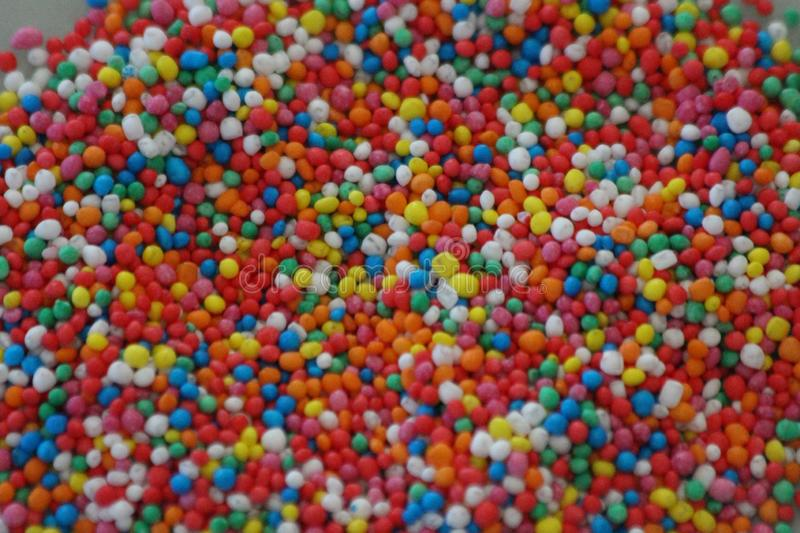 Hundreds and Thousands Sprinkles. Are popular to be used on cake toppings  , birthday cakes and my grandchildren love them on bread and butter and toast stock image