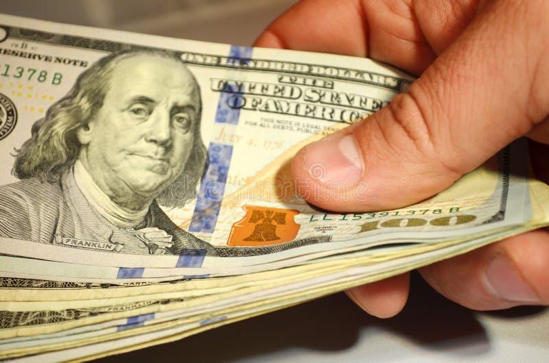 Hundreds. Wad of $100 dollar bills stock photos