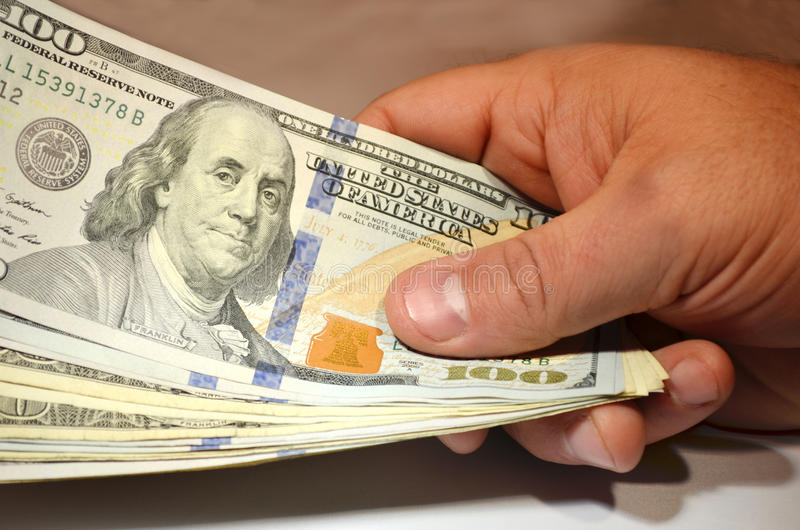 Hundreds. Wad of $100 dollar bills stock image