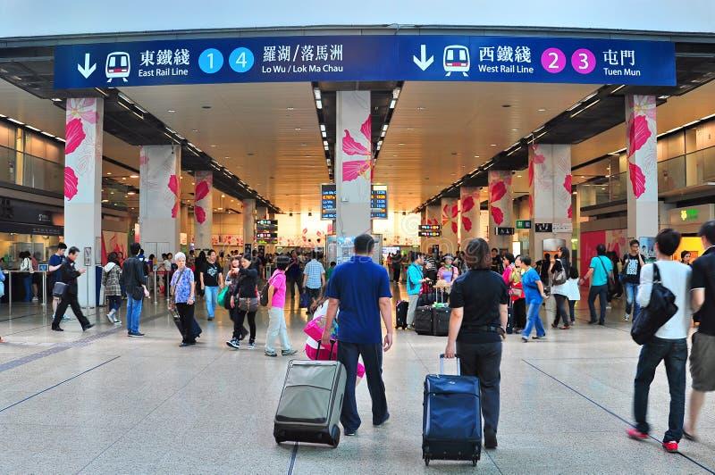 Hung hom railway station, hong kong. Passengers moving around at the main departure hall of hung hom railway station, one of the three hong kong ports of entry royalty free stock photo